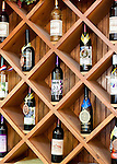 A display area exhibits Horton wines, on the wall behind the tasting bar at Horton Winery.
