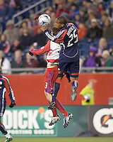 New England Revolution defender Darrius Barnes (25) and FC Dallas defender Drew Moor (3) battle for a head ball. The New England Revolution defeated FC Dallas, 2-1, at Gillette Stadium on April 4, 2009. Photo by Andrew Katsampes /isiphotos.com