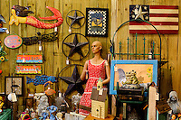 Some of the unique items available at the Depot at Gibson Mill, an antique and designer mall that was once a mill, located in Concord, N.C. With 85,000 square feet and 460 booths, the antique mall is one of the largest antique and designer mall in the South..Once a part of the old Cannon Mills, the charm of the 20 foot ceilings, wide wooden floors and exposed brick remains. Photo is part of a photographic series of images featuring Concord, NC, by Charlotte-based photographer Patrick Schneider..