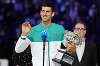 February 21, 2021: 1st seed Novak Djokovic of Serbia poses for photographs with the trophy defeating 4th seed Daniil Medvedev of the Russian Federation in the Men's Final match match on day 14 of the 2021 Australian Open on Rod Laver Arena, in Melbourne, Australia. Photo Sydney Low.