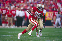 SAN FRANCISCO, CA - Jerry Rice of the San Francisco 49ers in action during a game against the New Orleans Saints at Candlestick Park in San Francisco, California in 1995. Photo by Brad Mangin