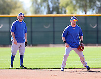 Ian Kinsler #5 (left) and Michael Young #10 of the Texas Rangers participates in spring training workouts at the Rangers complex on February 21, 2011  in Surprise, Arizona. .Photo by:  Bill Mitchell/Four Seam Images.