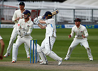 29th May 2021; Emirates Old Trafford, Manchester, Lancashire, England; County Championship Cricket, Lancashire versus Yorkshire, Day 3; Adam Lyth of Yorkshire hits out as the Lancashire come in close in an effort to break the Yorkshire opening partnership