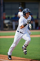 GCL Yankees East center fielder Raymundo Moreno (13) runs to first base during the first game of a doubleheader against the GCL Blue Jays on July 24, 2017 at the Yankees Minor League Complex in Tampa, Florida.  GCL Blue Jays defeated the GCL Yankees East 6-3 in a game that originally started on July 8th.  (Mike Janes/Four Seam Images)