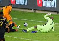 CARSON, CA - OCTOBER 28: Kenneth Vermeer #1 goalkeeper of the Los Angeles FC defends against advancing Mauro Manotas #9 of the Houston Dynamo during a game between Houston Dynamo and Los Angeles FC at Banc of California Stadium on October 28, 2020 in Carson, California.
