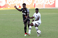 RICHMOND, VA - SEPTEMBER 30: Cherif Dieye #70 of New York Red Bulls II passes the ball past Akeem Ward #30 of North Carolina FC during a game between North Carolina FC and New York Red Bulls II at City Stadium on September 30, 2020 in Richmond, Virginia.