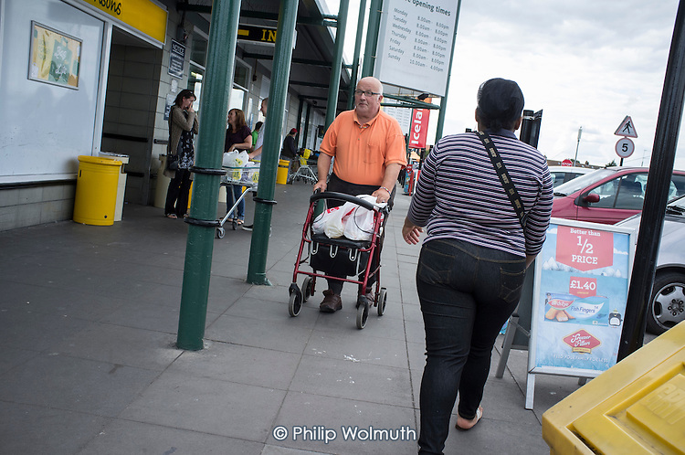 Man using a walking aid in Clacton.  The resort is the second most deprived seaside town in the UK.