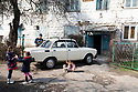 Uzbekistan - Tashkent - Daily life in Sputnik. Sputnik was built in 1966 after the earthquake to relocate part of the 300,000 people who had lost their house. The wooden houses were meant to cover the emergency but the area is still inhabited.