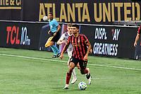 ATLANTA, GA - AUGUST 29: Miles Robinson #12 of Atlanta United dribbles the ball during a game between Orlando City SC and Atlanta United FC at Marecedes-Benz Stadium on August 29, 2020 in Atlanta, Georgia.