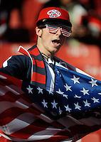 A USA football fan dances