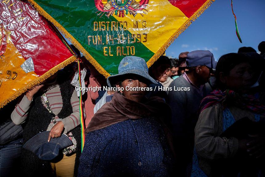 A woman attends a massive funeral of seven men killed during clashes between supporters of former Bolivian President Evo Morales with security forces during a demonstration in El Alto, on the outskirts of La Paz, Bolivia. At least nine people were killed in clashes outside a major fuel depot in Senkata, 40km from La Paz, that had been blockaded for days. November 20, 2019.<br /> Une femme assiste aux funérailles massives de sept hommes tués lors d'affrontements entre des partisans de l'ancien président bolivien Evo Morales et les forces de sécurité lors d'une manifestation à El Alto, à la périphérie de La Paz, en Bolivie. Au moins neuf personnes ont été tuées dans des affrontements devant un important dépôt de carburant à Senkata, à 40 km de La Paz, qui avait été bloqué pendant des jours. 20 novembre 2019.