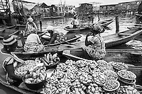 Floating Market  crowded with vendors and purchasers selling and buying agricultural products and local food.