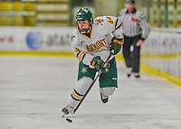 14 February 2015: University of Vermont Catamount Forward Victoria Andreakos, a Sophomore from Aurora, Ontario, leads a first period rush against the University of New Hampshire Wildcats at Gutterson Fieldhouse in Burlington, Vermont. The Lady Catamounts rallied from a 3-1 deficit to earn a 3-3 tie in the final home game of their NCAA Hockey East season. Mandatory Credit: Ed Wolfstein Photo *** RAW (NEF) Image File Available ***