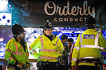"""© Joel Goodman - 07973 332324 . 19/12/2015 . Manchester , UK . Police outside the Orderly Conduct event at Deansgate Locks . Revellers in Manchester enjoy """" Mad Friday """" - also known as """" Black Eye Friday """" - the day on which emergency services in Britain are typically at their busiest , as people head out for parties and drinks to celebrate Christmas . Photo credit : Joel Goodman"""