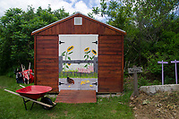 Painted mural on doors of garden shed. Yarmouth Community Garden, Maine USA