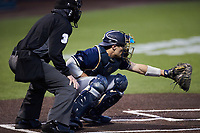 Georgia Tech Yellow Jackets catcher Kevin Parada (4) sets a target as home plate umpire Kevin Sweeney looks on during the game against the Virginia Tech Hokies at English Field on April 16, 2021 in Blacksburg, Virginia. (Brian Westerholt/Four Seam Images)