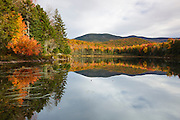 Reflection of autumn foliage in Kiah Pond in Sandwich, New Hampshire USA during the autumn season.