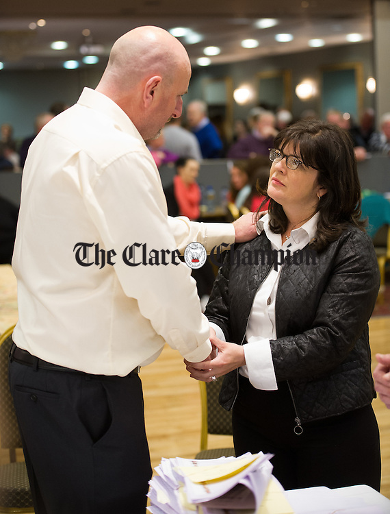 Fianna Fail's Clare Colleran Molloy and her competitor Ger O Halloran of Fine Gael shake hands as the result of a recount favouring Colleran Molloy is made clear during the election count at The West county Hotel, Ennis. Photograph by John Kelly.