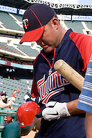 Minnesota Twins designated hitter Jim Thome #25 signs autographs before the Major League Baseball game against the Texas Rangers at the Rangers Ballpark in Arlington, Texas on July 27, 2011. Minnesota defeated Texas 7-2.  (Andrew Woolley/Four Seam Images)