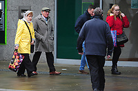 Pictured: A lady and man walk as they battle with the wind and rain in Swansea City Centre, Swansea Wales, UK. Friday 08 February 2019<br /> Re: