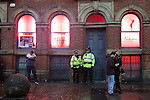 """© Joel Goodman - 07973 332324 . 19/12/2014 . Manchester , UK . Police on patrol outside Victorias Gentlemen's Club on Dantzic Street . """" Mad Friday """" revellers out in the rain and cold in Manchester . Mad Friday is typically the busiest day of the year for emergency services , taking place on the last Friday before Christmas when office Christmas parties and Christmas revellers enjoy a night out .  Photo credit : Joel Goodman"""