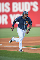 Toledo Mud Hens designated hitter Efren Navaro (17) runs toward home plate against the Louisville Bats during the International League baseball game on May 17, 2017 at Fifth Third Field in Toledo, Ohio. Toledo defeated Louisville 16-2. (Andrew Woolley/Four Seam Images)