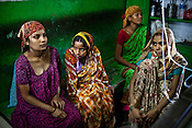 Women sit around and wait for doctors to visit their new born babies in pediatrics ward of Duncan Hospital in Raxaul of East Champaran district of Bihar, India. Since 2008 the Foundation and Geneva Global have been investing in the training of medical staff to improve the lives of people living in 600+ villages in the region. The NGOs are delivering cost effective interventions to address treatment, care and prevention of diseases, disability and preventable deaths amongst infants, adolescent girls and women of child-bearing age. There is statistical and anecdotal evidence that there have been vast improvements and a total of 40-50% increased immunization for all children under 6 has meant that communities can be serviced and educated long term. Photograph: Sanjit Das/Panos for Legatum Foundation