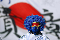 Japan fan in the stand before the game against Cameroon.