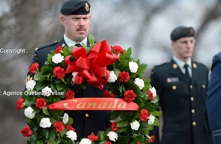 A member of the Canadian military presents wreath to the Right Honorable Justin Trudeau, Prime Minister of Canada prior to wreath laying ceremony at the Canadian Cross of Sacrifice at Arlington National Cemetery, Virginia.  In honor of Prime Minister Trudeau official visit to the United States, The Prime Minister also laid a wreath at the Tomb of the Unknowns.  (Department of Defense photo by Marvin Lynchard)