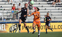 Becky Sauerbrunn (22) of the Washington Freedom heads the ball away from the onrushing Kerry Hanks (16) of Sky Blue.  Sky Blue defeated the Freedom 2-1 in the first WPS playoff game at the Soccerplex in Boyds, Maryland.