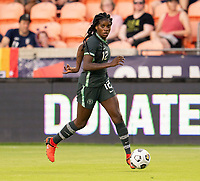 HOUSTON, TX - JUNE 13: Ijeoma Okonronkwo #12 of Nigeria dribbles the ball during a game between Nigeria and Portugal at BBVA Stadium on June 13, 2021 in Houston, Texas.