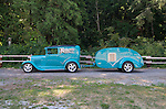 1929 turquoise Model A panel delivery truck pulling a turquoise Ken-Skill teardrop vintage travel tailer.