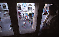 Young men playing volleyball in the streets of Ta'izz.