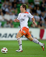 MELBOURNE, AUSTRALIA - DECEMBER 03: Matthew Smith of the Roar runs with the ball during the round 17 A-League match between the Melbourne Victory and the Brisbane Roar at AAMI Park on December 3, 2010 in Melbourne, Australia. (Photo by Sydney Low / Asterisk Images)