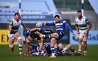 21st November 2020; Recreation Ground, Bath, Somerset, England; English Premiership Rugby, Bath versus Newcastle Falcons; Ben Spencer of Bath kicks under pressure from Sean Robinson of Newcastle Falcons