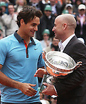June 7, 2009.Andre Agassi presents Roger Federer of Switzerland with the trophy after Federer defeated Robin Soderling of Sweeden in the final of the French Open, at Roland Garros, Paris