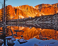 Evening light on the Snowy Range reflecting in Mirror lake in Medicine Bow National Forest, Wyoming