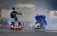 Oct. 1, 2011; Mohnton, PA, USA: NHRA top fuel dragster driver Brandon Bernstein (right) blows a tire taking out the rear wing alongside Doug Kalitta during qualifying for the Auto Plus Nationals at Maple Grove Raceway. Mandatory Credit: Mark J. Rebilas-