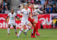 CARSON, CA - FEBRUARY 9: Julie Ertz #8 of the United States and Janine Beckie #16 of Canada fight for the ball during a game between Canada and USWNT at Dignity Health Sports Park on February 9, 2020 in Carson, California.