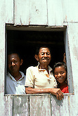 Rio Negro, Brazil. Caboclo family at the window of their home. They are Tucano Indians.