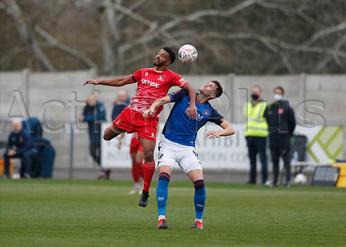 8th November 2020; SkyEx Community Stadium, London, England; Football Association Cup, Hayes and Yeading United versus Carlisle United; Karl Cunningham of Hayes & Yeading United heads the ball over Max Hunt of Carlisle United