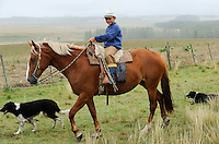 URUGUAY , Treinta y Tres, cattle farm , boy on horse / Rinderfarm, Junge auf Pferd