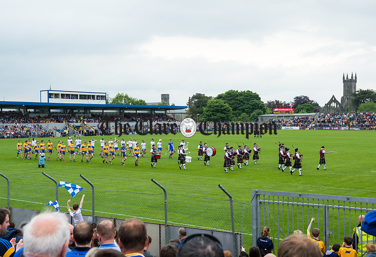 The teams parade before their Munster  championship round robin game at Cusack Park Photograph by John Kelly.