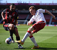 2nd April 2021; Vitality Stadium, Bournemouth, Dorset, England; English Football League Championship Football, Bournemouth Athletic versus Middlesbrough; Duncan Watmore of Middlesbrough crosses under pressure from Cameron Carter-Vickers of Bournemouth