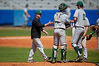 Dartmouth Big Green head coach Bob Whalen (2) takes the ball from pitcher Zac Bygum (12) for a pitching change as catcher Ben Rice (9) looks on during a game against the Bradley Braves on March 21, 2019 at Chain of Lakes Stadium in Winter Haven, Florida.  Bradley defeated Dartmouth 6-3.  (Mike Janes/Four Seam Images)