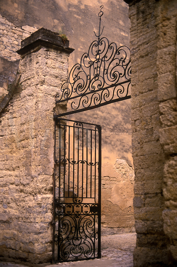 Decorative wrought iron gate at entrance to home in village of Uzes, Provence, France