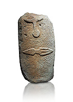 Late European Neolithic prehistoric Menhir standing stone with carvings on its face side. The representation of a stylalised male figure starts at the top with the bottom of a carving of a falling figure with head at the bottom and 2 curved arms encircling a body above. at the bottom is a carving of a dagger running horizontally across the menhir. Excavated from Piscina 'E Sali V site,  Laconi. Menhir Museum, Museo della Statuaria Prehistorica in Sardegna, Museum of Prehoistoric Sardinian Statues, Palazzo Aymerich, Laconi, Sardinia, Italy. White background.