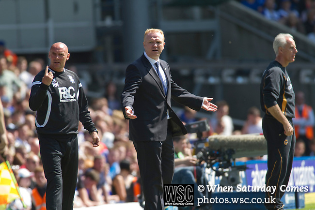 Birmingham City 1 Wolverhampton Wanderers 1, 01/05/2011. St Andrews, Premier League. Home manager Alex McLeish (centre) and coach Andy Watson (left) become animated in the first half at St. Andrew's stadium, during Birmingham City's Barclay's Premier League match with Wolverhampton Wanderers. Both clubs were battling against relegation from  England's top division. The match ended in a 1-1 draw, watched by a crowd of 26,027. Photo by Colin McPherson.