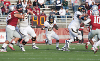 Isi Sofele finds the hole thanks for blocks by Matt Summers-Gavin (left) and Mitchell Schwartz (right). The University of California football defeated Washington State University 20-13 at Martin Stadium in Pullman, Washington on November 6th, 2010.