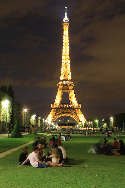 Visitors on the Champ de Mars with the Eiffel Tower at night, Paris, France. .  John offers private photo tours in Denver, Boulder and throughout Colorado, USA.  Year-round. .  John offers private photo tours in Denver, Boulder and throughout Colorado. Year-round.
